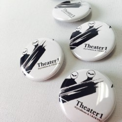theater-1-badge